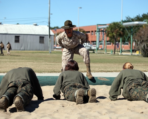 U.S. Marine Sgt. Katheryn Swingle, drill instructor, Oscar Company, 4th Recruit Training Battalion, Recruit Training Regiment, Marine Corps Recruit Depot Parris Island, conducts incentive physical training to instill order and discipline during the first phase of recruit training aboard Marine Corps Recruit Depot Parris Island, S.C., Oct. 29, 2012. Incentive physical training consists of rigorous exercises such as Marine Corps push-ups, mountain climbers, side straddle hops, and crunches. (U.S. Marine Corps photo by Cpl. Aneshea S. Yee/Released)
