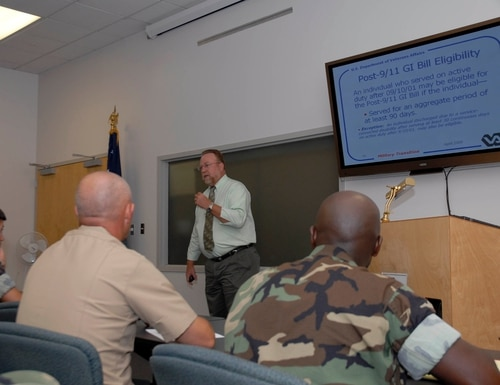 A veterans benefits coordinator for the briefs troops and retirees on the GI Bill benefits at Naval Construction Battalion Center in Gulfport, Miss., in July 2009. (Petty Officer 1st Class Sam Spain/Navy)