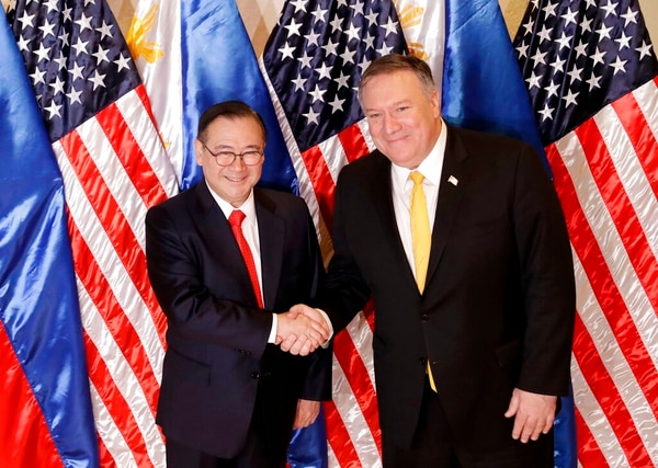 Philippine Foreign Affairs Secretary Teodoro Locsin Jr., left, and U.S. Secretary of State Mike Pompeo shake hands prior to their bilateral meeting in suburban Pasay city, southeast of Manila on Friday. Pompeo is in the Philippines for talks on the two countries' relations as well as the mutual defense treaty. (Bullit Marquez/AP)