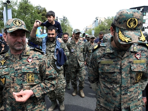 Members of the Iran's powerful Revolutionary Guards attend a rally against the U.S.'s decision to designate the guard as a foreign terrorist organization, after prayers at the Enqelab-e-Eslami (Islamic Revolution) street in Tehran, Iran, on April 12, 2019. (Vahid Salemi/AP)