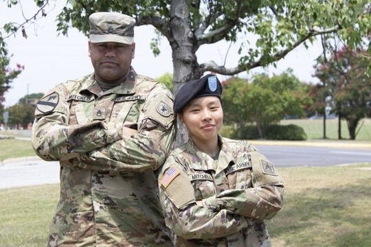 Staff Sgt. Joshua Mitchell and his wife Spc. Eunjee Mitchell are shown at Fort Jackson, South Carolina on July 31. Spc. Mitchell decided to enlist after listening to her Army recruiter husband for two years. (Alexandra Shea)