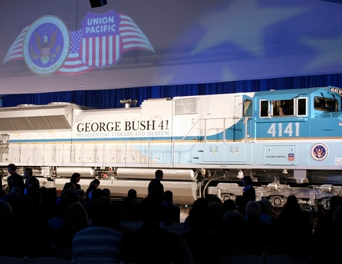 In this Oct. 18, 2005, file photo, a new locomotive numbered 4141 in honor of the 41st president, George H.W. Bush, is unveiled at Texas A&M University in College Station, Texas. The locomotive unveiled for the special exhibit at George H.W. Bush's presidential library will be used to pull the late president's funeral train. The 4,300-horsepower machine will carry Bush's remains Thursday, Dec. 6, 2018, to his final resting place at his presidential library. (Pat Sullivan/AP)