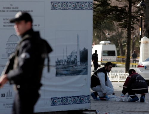 Policemen search for evidence at the historic Sultanahmet district after an explosion in Istanbul, Tuesday, Jan. 12, 2016. An explosion in a historic district of Istanbul popular with tourists killed 10 people and injured 15 others Tuesday morning, the Istanbul governor's office said. (AP Photo/Lefteris Pitarakis)