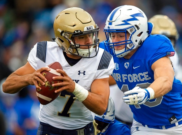 Navy quarterback Garret Lewis avoids Air Force linebacker Kyle Johnson at Falcon Stadium at the U.S. Air Force Academy on Saturday. (Dougal Brownlie,/The Gazette via AP)