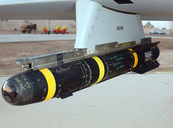 An intact AGM-114 Hellfire missile attached to an MQ-1 Predator drone. (Tech. Sgt. Scott Reed/Air Force)