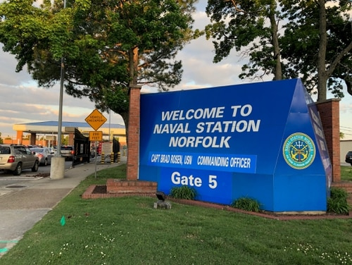 The gate at Naval Station Norfolk where a Marine Raider is facing a life sentence over the death of an Army Green Beret in Mali four years ago. (Todd South/Staff)
