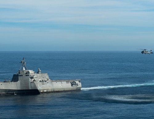 The Independence-variant littoral combat ship Coronado conducts operations with an MH-60S Seahawk helicopter on Nov. 1, 2018. (MC2 Chelsea Meiller/U.S. Navy)