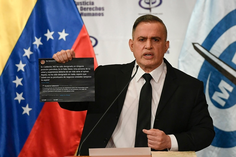Venezuela's Attorney General Tarek William Saab holds up Twitter posts during a press conference regarding what the government calls a failed attack over the weekend aimed at overthrowing President Nicolás Maduro in Caracas, Venezuela, Monday, May 4, 2020. The Twitter posts are between two members of the opposition, Humberto Calderon and Yon Goicoechea. (Matias Delacroix/AP)