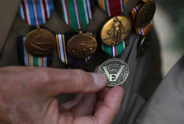 Donald Cobb, 95, who was in the U.S. Navy, shows his medals during an interview Friday, Aug.23, 2019 in Paris. Cobb, who was aboard the USS Murphy during the battles of Normandy, Southern France, North Africa and in the Mediterranean Sea, was part of a group of World War II veterans taking part in commemorations of the 75th anniversary of the Allied operation to liberate Paris from Nazi occupation. (Daniel Cole/AP)