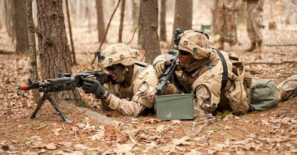U.S. Marine Corps officers with Alpha Company, The Basic School (TBS), provide security during urban operations training at Marine Corps Base Quantico, Va., 28 March 2014. TBS is where newly commissioned officers learn the basics of combat. (Cpl. Sonia N. Rodriguez/Marine Corps)
