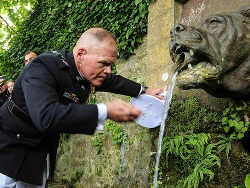 Marine Corps Commandant Gen. Robert Neller drinks from Bulldog Fountain after a ceremony at the Aisne-Marne Cemetery, Belleau, France, May 27, 2018. The ceremony honored the 100th anniversary of the Battle of Belleau Wood during World War I. (Sgt. Olivia G. Ortiz/Marine Corps)