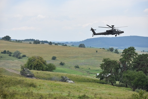 AH-64 Apache helicopters fire on targets as M2A1 Bradley fighting vehicles move into position as part of Getica Saber 17 near the Joint National Training Center - Romania. (Army)