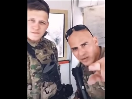Two soldiers from the Michigan Army National Guard's Company A, 3rd Battalion, 126th Infantry, face discipline after posting a politically charged