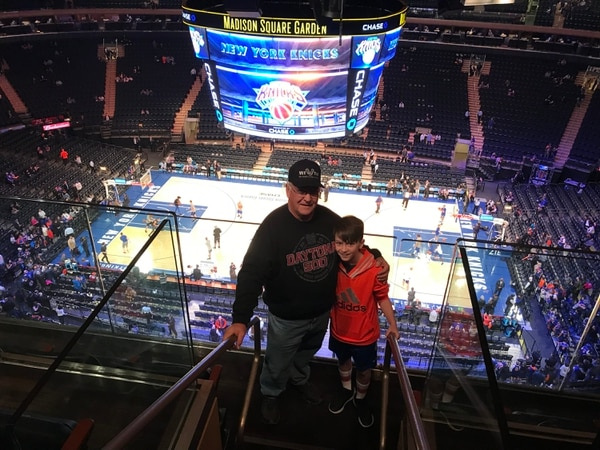 Army veteran Bob Hanna takes his grandson to his first NBA game to see the New York Knicks at Madison Square Garden, Dec. 3, 2017. (Vet Tix)