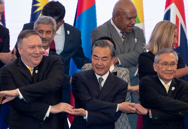 U.S. Secretary of State Mike Pompeo, left, China's Foreign Minister Wang Yi, center, and Thailand's Foreign Minister Don Pramudwinai cross their arms during the Association of Southeast Asian Nations Regional Forum in Bangkok on Aug. 2. (Gemunu Amarasinghe/AP)