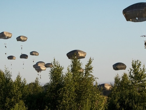 U.S. Army paratroopers assigned to the 3rd Brigade Combat Team, 82nd Airborne Division, jump into Lithuania as part of Swift Response 2018. This year's Swift Response exercise will be massive. (Army)
