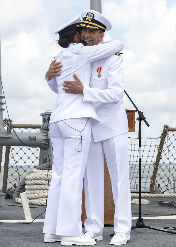 Tyrone Krause, a chief heart surgeon in New Jersey, embraces his daughter, Ensign Laura Krause, after they recited the oath to commission the 63-year-old surgeon as a Navy officer. (MCSN Maxwell Anderson/Navy)