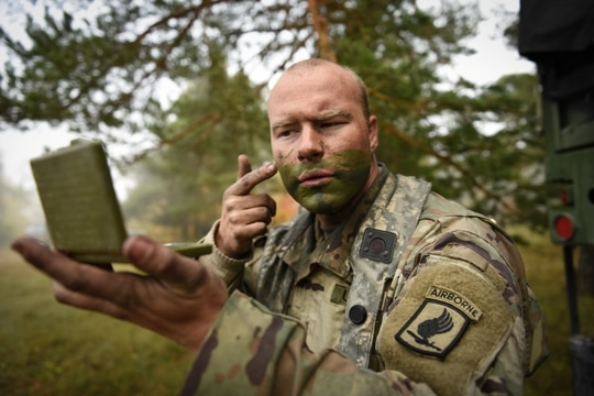 A U.S. Army Paratrooper assigned to the 173rd Airborne Brigade applies face paint during exercise Swift Response 17 in Hohenfels, Germany. (Staff Sgt. Alexander C Henninger/Army)