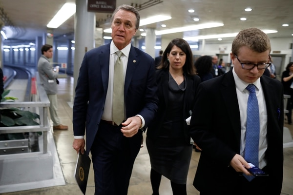 Sen. David Perdue (R-GA) walks with aides on Capitol Hill on February 14, 2018 in Washington, DC.(Photo by Aaron P. Bernstein/Getty Images)