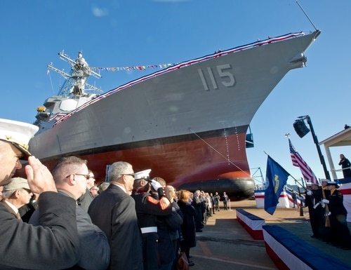 U.S. Marines, Sailors, and guests honor the American and Navy flag during the USS Rafael Peralta christening ceremony at General Dynamics Bath Iron Works, Bath, Maine, Oct. 31, 2015. The destroyer was named after Marine Corps Sgt. Rafael Peralta who was killed during the second battle of Fallujah in 2004. (Sgt. Gabriela Garcia/Marine Corps)