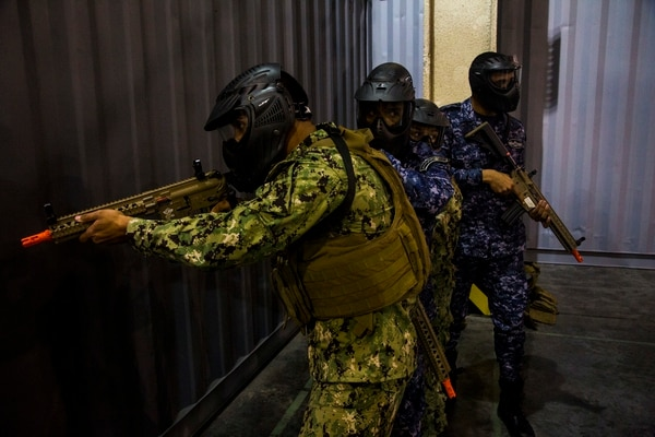 Personnel participate in Neon Response, a bilateral explosive ordnance disposal and maritime security exercise between the U.S. Navy and Bahrain Defense Force. (Spc. Vincent Fausnaught/Army).