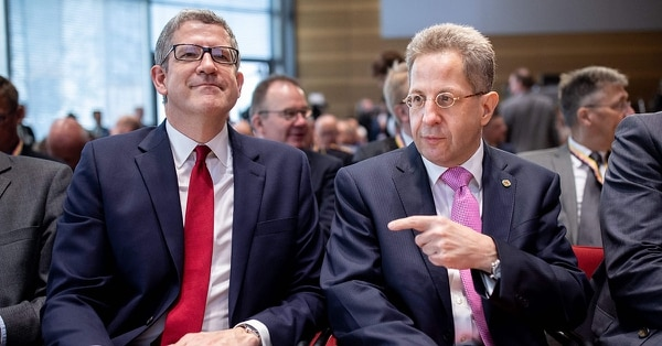 Hans-Georg Maassen, President of Germany's Federal Office for the Protection of the Constitution (Bundesamt fuer Verfassungsschutz), points at Andrew Parker, Director-General of the British Security Service MI5, as they attend a conference themed
