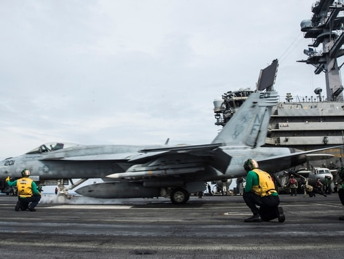 "An F/A-18E assigned to the ""Royal Maces"" of Strike Fighter Squadron 27 launches off the flight deck of the aircraft carrier Ronald Reagan Thursday in the South China Sea. (Mass Communication Specialist 2nd Class Codie L. Soule/Navy)"