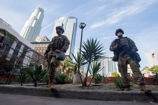 In this May 31, 2020, file photo members of the California National Guard patrol in Los Angeles. (Ringo H.W. Chiu/AP)