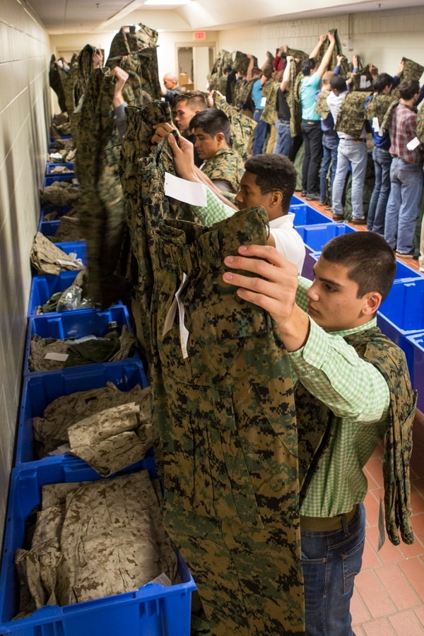 New Marine Corps recruits of Echo Company, 2nd Recruit Training Battalion, inventory their clothing issue Jan. 8, 2018, on Parris Island, S.C. The uniform items are a part of the initial issue that every recruit receives when they arrive on Parris Island. (Cpl. Vanessa Austin/Marine Corps)