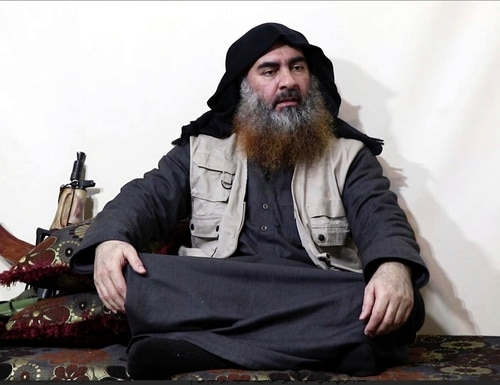 This image made from video posted on a militant website on Monday, April 29, 2019, purports to show the leader of the Islamic State group, Abu Bakr al-Baghdadi, being interviewed by his group's Al-Furqan media outlet. Al-Baghdadi acknowledged in his first video since June 2014 that ISIS lost the war in the eastern Syrian village of Baghouz that was captured last month by the Kurdish-led Syrian Democratic Forces. (Al-Furqan media via AP)
