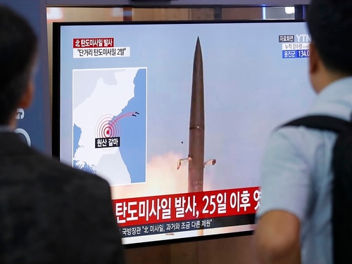 People watch a TV showing a file image of North Korea's missile launch during a news program at the Seoul Railway Station in Seoul, South Korea, Wednesday, July 31, 2019. (Ahn Young-joon/AP)