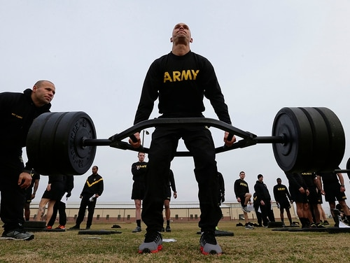 Army 1st Lt. Mitchel Hess participates in a weight lifting drill while preparing to be an instructor in the new Army Combat Fitness Test at Fort Bragg, N.C. (Gerry Broome/AP)