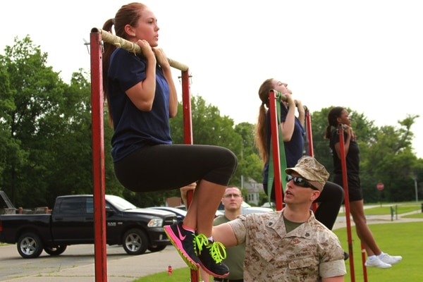 Janna Smith, an 18 year old Marine Corps poolee from Recruiting Sub-Station Livonia, conducts the flexed-arm hang during Recruiting Station Detroit's bi-annual female pool function at the Boys and Girls Club of Troy, Michigan, June 20, 2015. The flexed arm hang is the first of three events the poolees performed during their Initial Strength Test. (U.S. Marine Corps photo by Cpl. J.R. Heins/Released)