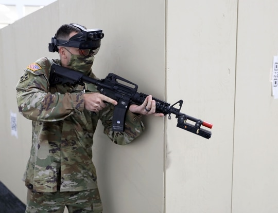 A soldier runs through a shoothouse scenario with new augmented reality goggles in the Soldier Integration Facility at Fort Belvoir, Virginia. (Courtney Bacon/PEO Soldier)