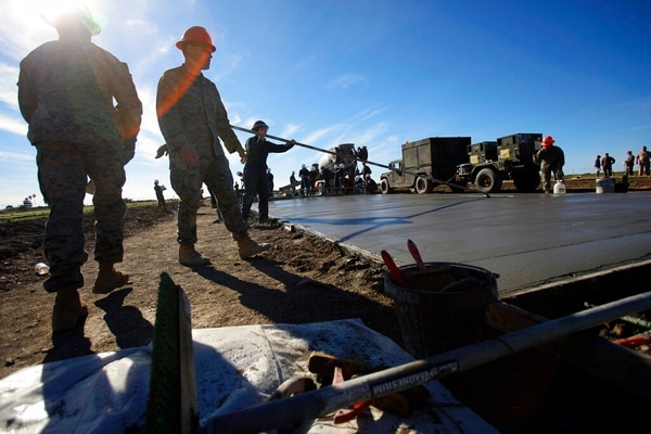 Marines and Navy Seabees rebuilding the mountaintop runway on storied Santa Catalina Island, Calif., on Friday. (Damian Dovarganes/AP)