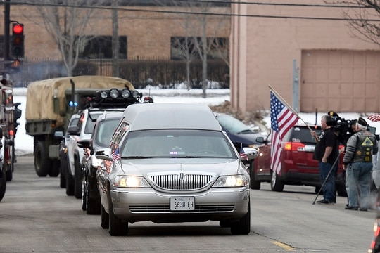 Hundreds of people gathered for the funeral of another 'unclaimed' veteran in Elgin, Illinois earlier in 2020. (Rick West/Daily Herald via AP)