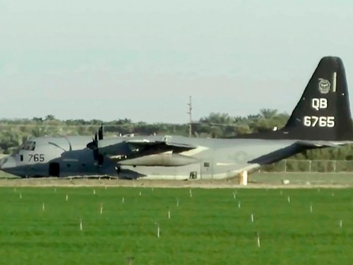 A KC-130J tanker is seen after it made an emergency landing after colliding with an F-35B fighter jet during a refueling operation over the Southern California desert near Thermal on Sept. 29, 2020. (KESQ-TV via AP)
