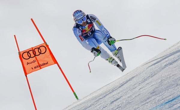 Bode Miller, of United States, is airborne as he takes a jump during training for Saturday's men's World Cup downhill's in Kitzbuehel, Austria, Thursday, Jan. 22, 2015. (AP Photo/Shinichiro Tanaka)