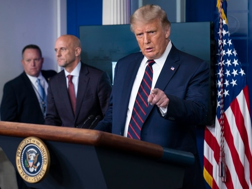 President Donald Trump (right) speaks during a media briefing in the James Brady Briefing Room of the White House on Aug. 23, 2020. (Alex Brandon/AP)