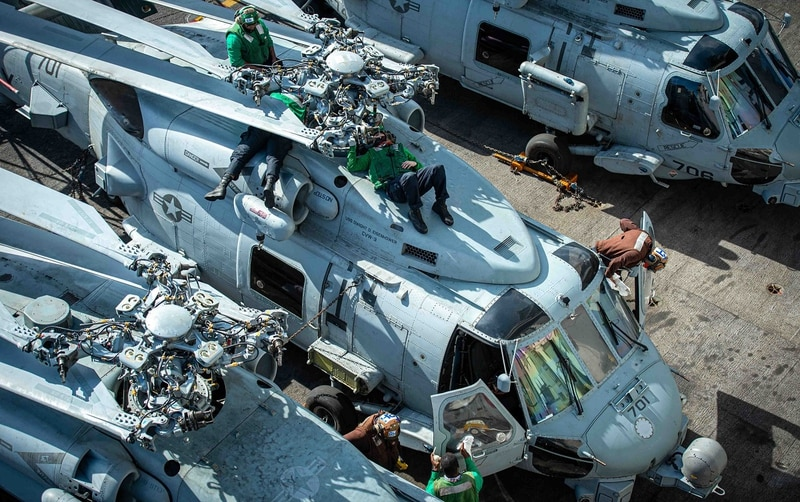 Sailors perform maintenance Wednesday on an MH-60R Sea Hawk, attached to Helicopter Maritime Strike Squadron 74, aboard the Nimitz-class aircraft carrier Dwight D. Eisenhowers. (MCSN Orion Shotton/Navy)