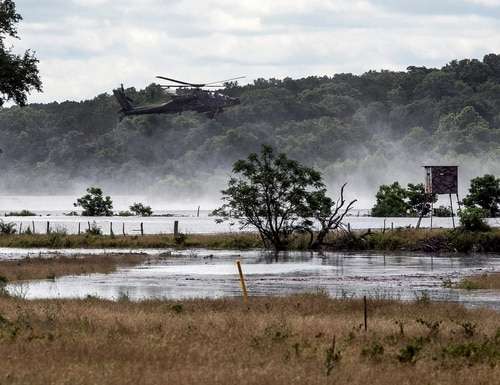 Army helicopters hover above Lake Belton Friday, June 3, 2016, searching for four missing soldiers from U.S Army's Fort Hood that were swept away in a low water crossing during training when the Army vehicle they were in was swept away on Thursday. Five soldiers were killed, four are still missing and three were rescued on Thursday. (Rodolfo Gonzalez/Austin American-Statesman via AP)