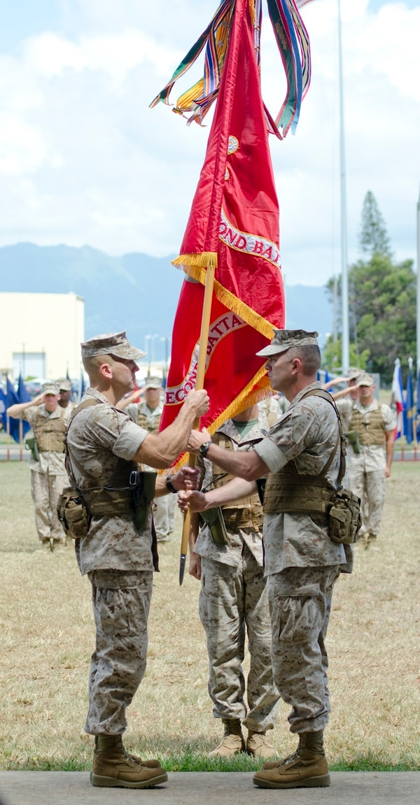 Lt. Col. Brian P. Coyne (left), incoming commanding officer, 2nd Battalion, 3rd Marine Regiment, accepts the unit colors from Lt. Col. James B. Conway, outgoing commanding officer, during the change of command ceremony at Dewey Square, July 18, 2014. (U.S. Marine Corps photo by Kristen Wong)