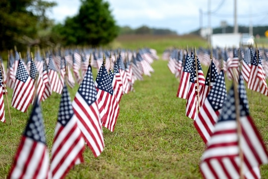 American flags stand outside of a 177th Fighter Wing building in Egg Harbor Township, N.J., Sept. 1, 2020. The 660 flags represent the approximate amount of veterans who die by suicide each month in the United States. (Airman 1st Class Hunter Hires/Air National Guard)