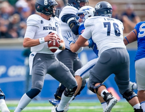 Nevada quarterback Ty Gangi (6) looks for an open player during the first half of an NCAA college football game against Air Force, Saturday, Sept. 29, 2018 in Colorado Springs, Colo. (Dougal Brownlie/The Gazette via AP)