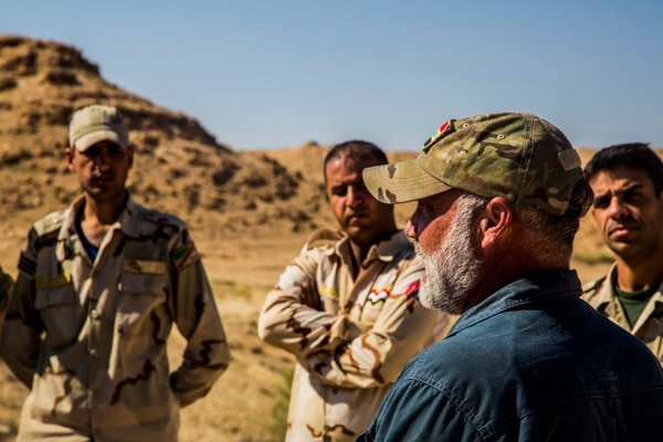 Iraqi soldiers listen to a civilian contractor attached to Task Force Al Asad, talk about counter-improvised explosive device at Al Asad Air Base, Iraq. (Lance Cpl. Skyler E. Treverrow/Marine Corps)