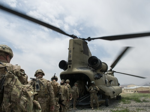 U.S. soldiers enter an Army CH-47 Chinook helicopter at an Afghan National Army combat outpost in Afghanistan on June 23, 2015. (Tech. Sgt. Joseph Swafford/Air Force)
