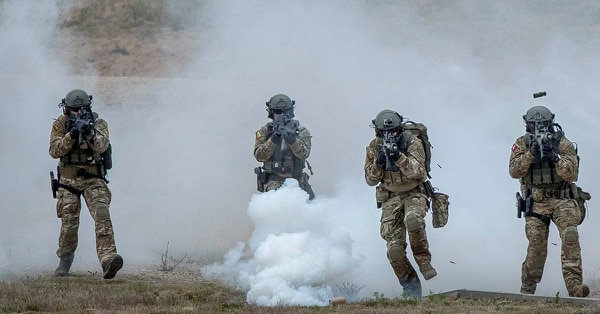 Lithuanian soldiers take part in a military exercise with NATO allies, including Poland and the other two Baltic states of Estonia and Latvia. (Mindaugas Kulbis/AP)
