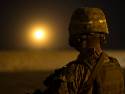 A Marine with Task Force Southwest looks at a 120 mm mortar illumination round fired on Bost Airfield, Afghanistan, April 24. (Cpl. Roderick L. Jacquote/Marine Corps)