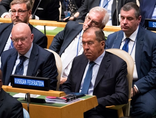 Russian Foreign Minister Sergey Lavrov, right, and Ambassador to the United Nations Vassily Nebenzia, center, listen as American President Donald Trump addresses the 73rd session of the United Nations General Assembly on Sept. 25, 2018, at U.N. headquarters. (Mary Altaffer/AP)