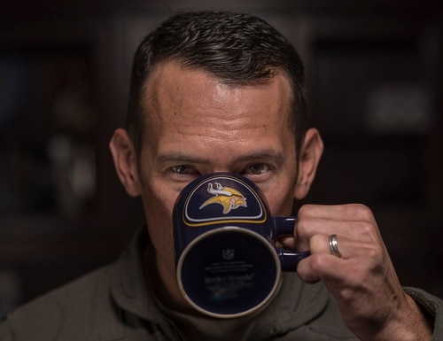 Col. Paul Moga, 33rd Fighter Wing commander at Eglin Air Force Base, Fla., takes a sip of coffee from a mug with his favorite sport team's logo. At Travis Air Force Base, coffee mugs are costing the 60th Aerial Port Squadron $1,220 a piece, prompting some innovative airmen to develop their own 3-D solution. (Staff Sgt. Peter Thompson/Air Force)